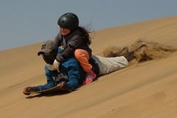 Lie down sandboarding