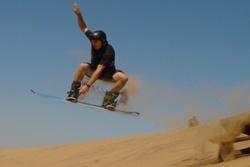 Stand up sandboarding